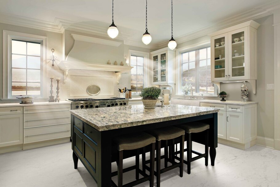 Wentwood Cambria Quartz Kitchen Countertops with Black and White Wood Cabinets, Bar Stools, and Stainless Steel